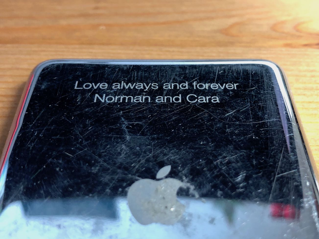 "The back plate of one of the replacement parts I ordered with the etching ""Love always and forever / Norman and Cara"""