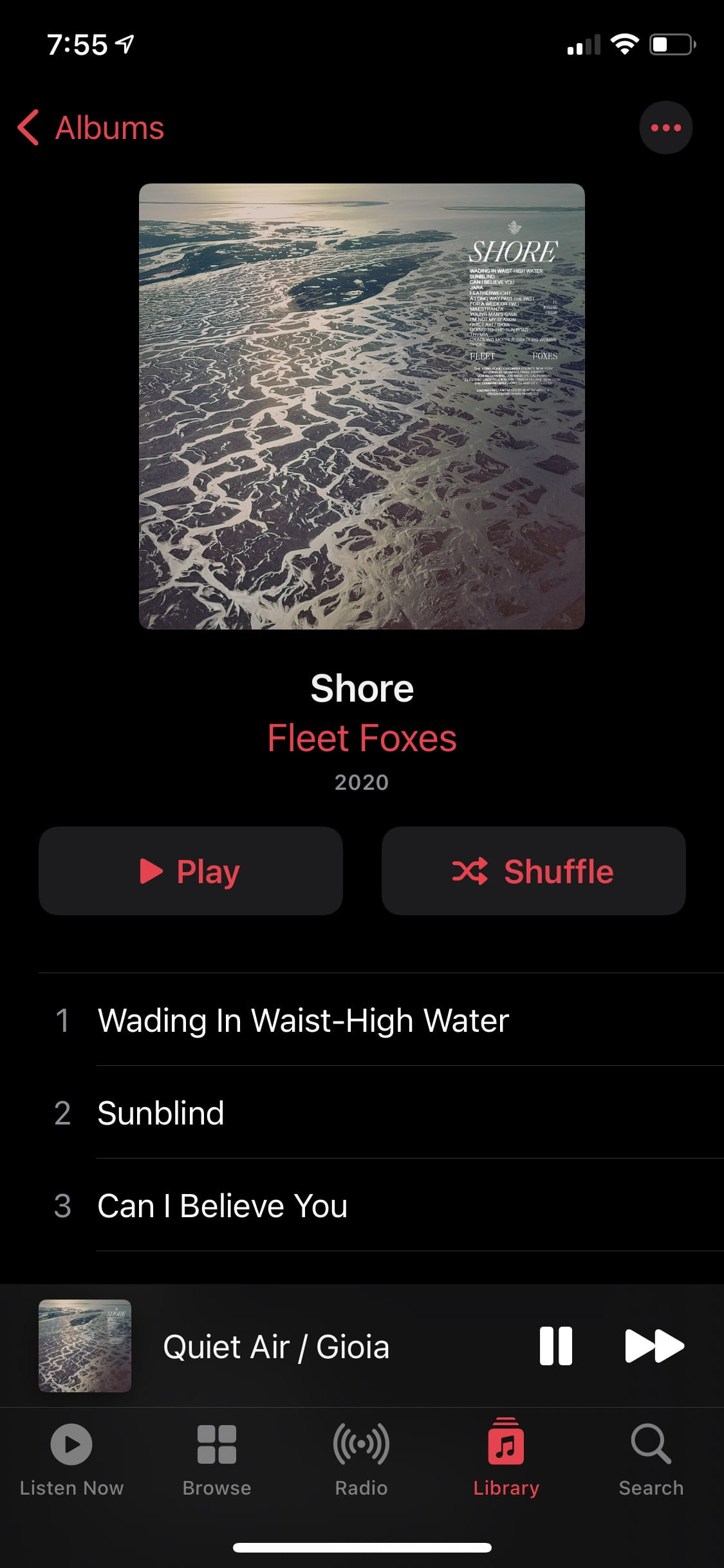 """Image of """"Music.app"""" dark album view"""