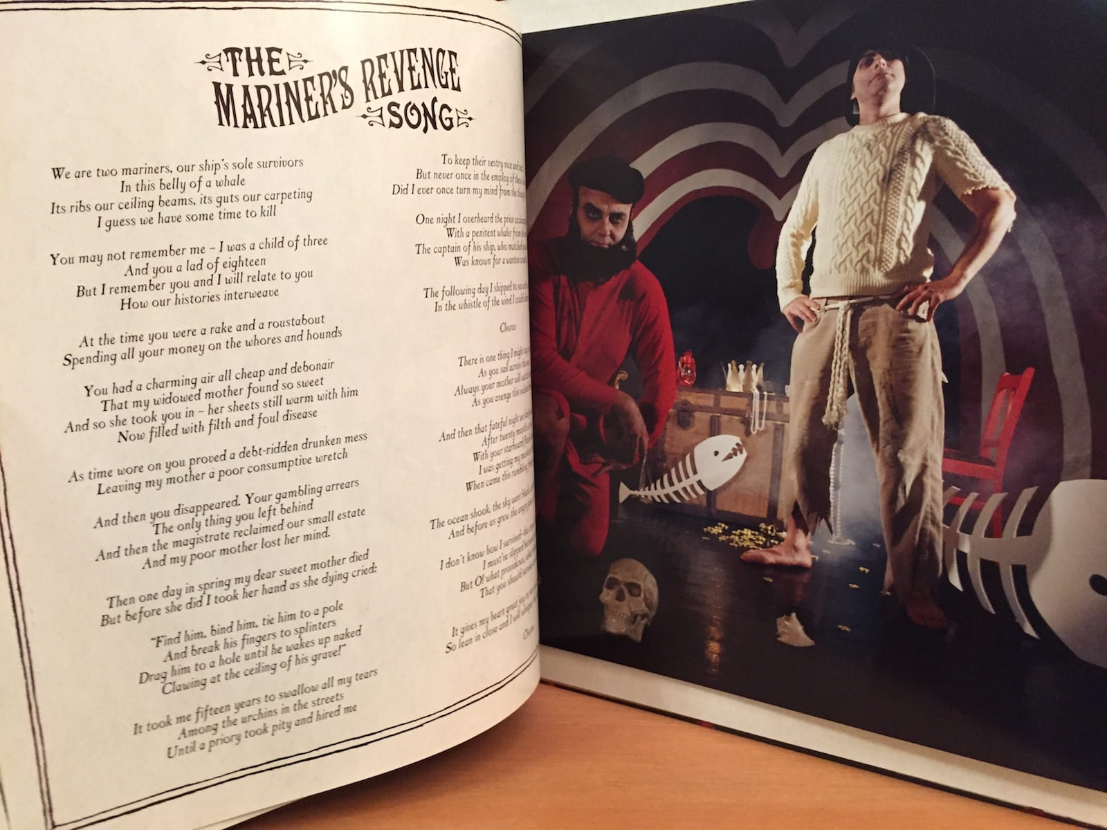 "The Decemberists's ""Picaresque"" lyric book, showing the page for the picture and lyrics of ""The Mariner's Revenge Song"""